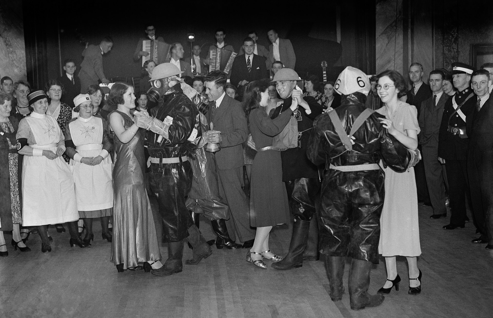 The ARP ( Air Raid Precautions ) and AFS ( Army Fire Service ) dance at Crayford Town Hall , Kent . 18 January 1939