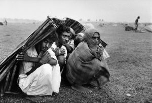 Refugees from the war and genocide in East Pakistan seek shelter in West Bengal, India at the start of the monsoon season. Photograph by Mark Godfrey