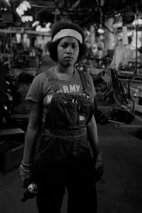 Portrait of a worker on the auto assembly line at the Checker auto factory in Kalamazoo, Michigan (1977). Checker Motors Corporation was a vehicle manufacturer that manufactured taxicabs used by Checker Taxi. The final models were produced in 1982. Photograph by Mark Godfrey