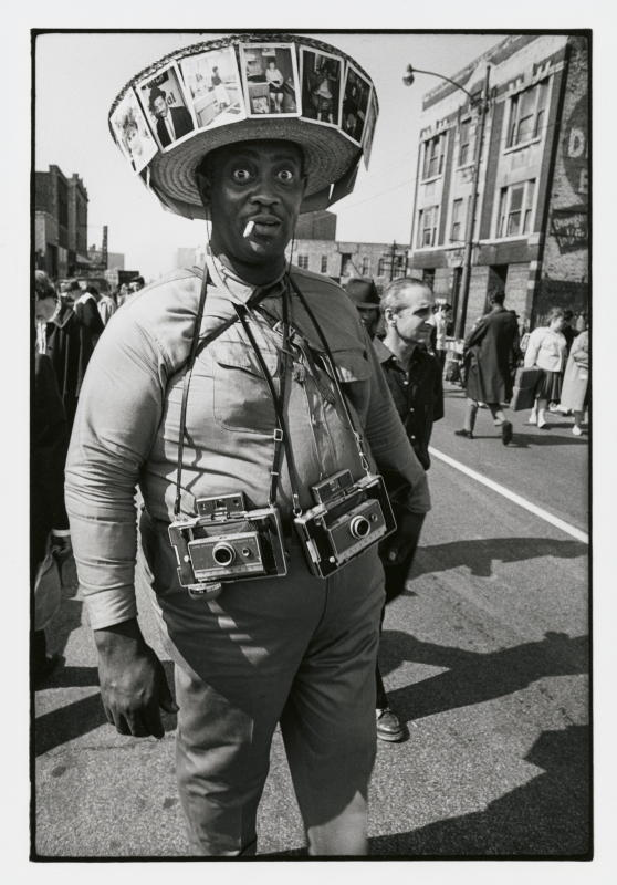 CHM003559: Photographer on Maxwell Street, 1970. Chicago History Museum/James Newberry/TopFoto