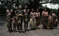 Members of the Iounhanan tribe from the island of Tanna (Vanuatu) who worship the Duke of Edinburgh. Their treasure and the 'one true cross' is this signed photograph which Prince Phillip kindly provided. The tribe's fervent wish is that he will come and live with them and wives, like the girls pictured, would be available to him should he wish to change his marital status. Photograph by Colin Jones